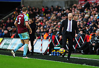 Burnley's Charlie Taylor interacts with Burnley manager Sean Dyche <br /> <br /> Photographer Ashley Crowden/CameraSport<br /> <br /> The Premier League - Swansea City v Burnley - Saturday 10th February 2018 - Liberty Stadium - Swansea<br /> <br /> World Copyright &copy; 2018 CameraSport. All rights reserved. 43 Linden Ave. Countesthorpe. Leicester. England. LE8 5PG - Tel: +44 (0) 116 277 4147 - admin@camerasport.com - www.camerasport.com