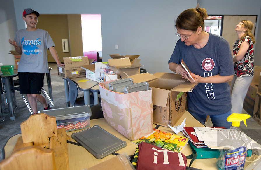 NWA Media/JASON IVESTER --08/21/2014--<br /> English teacher Kathleen Reiboldt (cq) unpacks boxes in her new classroom on Thursday, Aug. 21, 2014, inside the new Joplin High School in Joplin, Mo. The school was originally scheduled to open with the rest of the school district on Monday, Aug. 25, but was pushed back to Tuesday, Sept. 2.