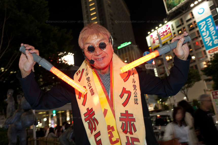 Politician and entertainer, Makoto Tonami also known as Mac Akasaka of the fringe, Japam Smile Party campaigning in Shibuya, Tokyo, Japan Friday May 17th 2013