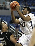 Agassi Prep's Anson WIlliams drives into West Wendover's Adrian Enriquez during the NIAA 2A State Basketball Championship game between West Wendover and Agassi Prep high schools at Lawlor Events Center, in Reno, Nev, on Saturday, Feb. 25, 2012. .Photo by Cathleen Allison