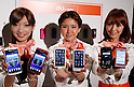 May 17th, 2011, Tokyo, Japan - Models display a new lineup KDDI's Android smart phones at a news conference in Tokyo on Tuesday, May 17, 2011. The communication carrier launched a new lineup of 14 models for 2011 summer, including six smart phones and six mobile phones, plus two Wi-Fi mobile routers. (Photo by AFLO) [3609] -mis-.