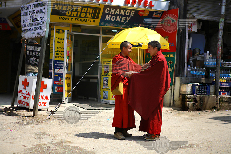Monks talk on a street in the town of Mcleod Ganj, home to a large community of exiled Tibetans.