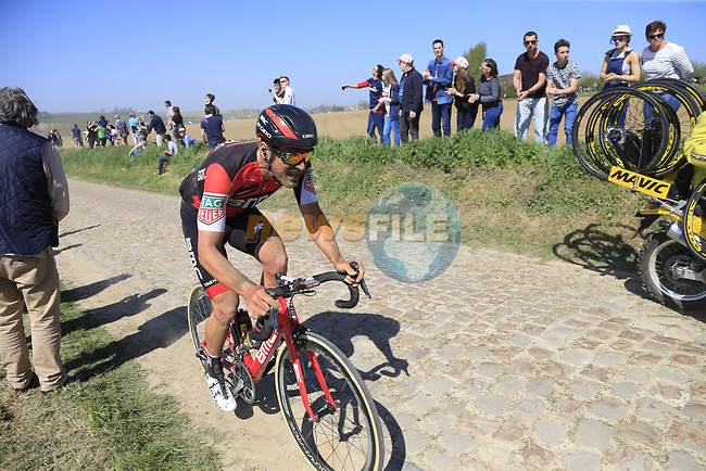 The peloton including Jean-Pierre Drucker (LUX) BMC Racing Team on pave sector 25 Briastre a Solesmes during the 115th edition of the Paris-Roubaix 2017 race running 257km Compiegne to Roubaix, France. 9th April 2017.<br /> Picture: Eoin Clarke   Cyclefile<br /> <br /> <br /> All photos usage must carry mandatory copyright credit (&copy; Cyclefile   Eoin Clarke)