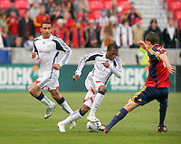 Real Salt Lake Midfielder Will Johnson (8) fights to win the ball from New England Revolution Midfielder Sainey Nyassi (31) and Defender Amaechi Igwe (2) in the Real Salt Lake 6-0 win over New England Revolution, April 25, 2009 at Rio Tinto Stadium in Sandy, Utah.