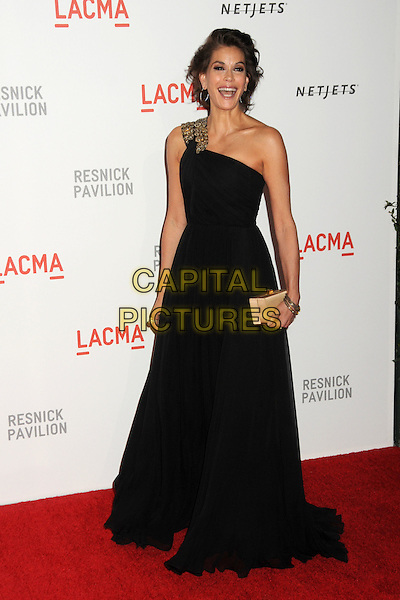 "TERI HATCHER .at LACMA's ""The Unmasking"" The Lynda & Stewart Resnick Exhibition Pavilion Opening Gala at The Los Angeles County Museum of Art in Los Angeles, California, USA, September 25th 2010..full length black one shoulder long maxi dress gown gold box clutch bag   .CAP/ADM/BP.©Byron Purvis/AdMedia/Capital Pictures."