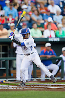 Florida Gators shortstop Richie Martin (12) at bat against the Miami Hurricanes in the NCAA College World Series on June 13, 2015 at TD Ameritrade Park in Omaha, Nebraska. Florida defeated Miami 15-3. (Andrew Woolley/Four Seam Images)