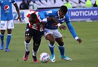 BOGOTA -COLOMBIA, 6-08-2017.Harold Mosquera (Der.) jugador de Millonarios disputa el balón con Yonatan Murillo (Izq. jugador de Atlético Junior durante partido por la fecha 6 de la Liga Aguila II 2017 jugado en el estadio Nemesio Camacho El Campin de la ciudad de Bogota. / Harold Mosquera (R) player of Millonarios fights for the ball with Yonatan Murillo (L) player of Atletico Junior during match for the date 6 of the Liga Aguila II 2017 played at the Nemesio Camacho El Campin Stadium in Bogota city. Photo:VizzorImage / Felipe Caicedo  / Staff