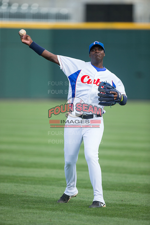 Rudy Reyes Erise (10) of the Cuban National Team warms up prior to the game against the US Collegiate National Team at BB&T BallPark on July 4, 2015 in Charlotte, North Carolina.  The United State Collegiate National Team defeated the Cuban National Team 11-1.  (Brian Westerholt/Four Seam Images)