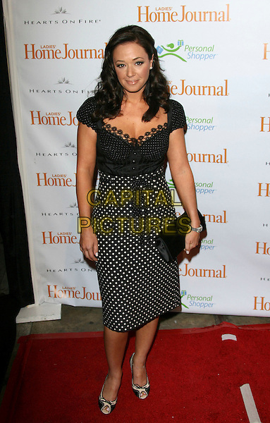 "LEAH REMINI.Third Annual ""Funny Ladies We Love"" Awards Hosted By Ladies' Home Journal - Arrivals held at the Cabana Club, Hollywood, California.  .February 6th, 2006.Photo: Zach Lipp/AdMedia/Capital Pictures.Ref: ZL/ADM.full length black white polka dot dress clutch purse peep toe.www.capitalpictures.com.sales@capitalpictures.com.© Capital Pictures."
