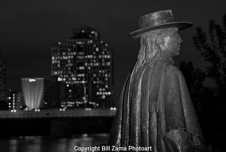 Light painted night photo of the Stevie Ray Vaughan statue on Ladybird Lake in Austin.  Credits to Ralph Helmick the Sculptor who created this work.