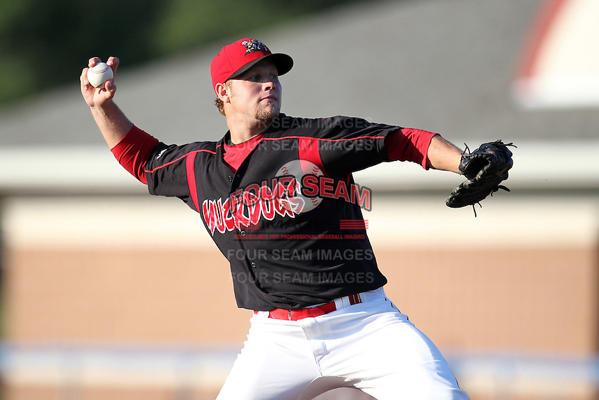 Batavia Muckdogs pitcher Andy Moss (33) delivers a pitch during a game vs. the Williamsport Crosscutters at Dwyer Stadium in Batavia, New York July 26, 2010.   Batavia defeated Williamsport 3-2.  Photo By Mike Janes/Four Seam Images