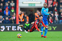 Alexandre Lacazette of Arsenal right appears to foul Adam Smith of AFC Bournemouth during AFC Bournemouth vs Arsenal, Premier League Football at the Vitality Stadium on 14th January 2018