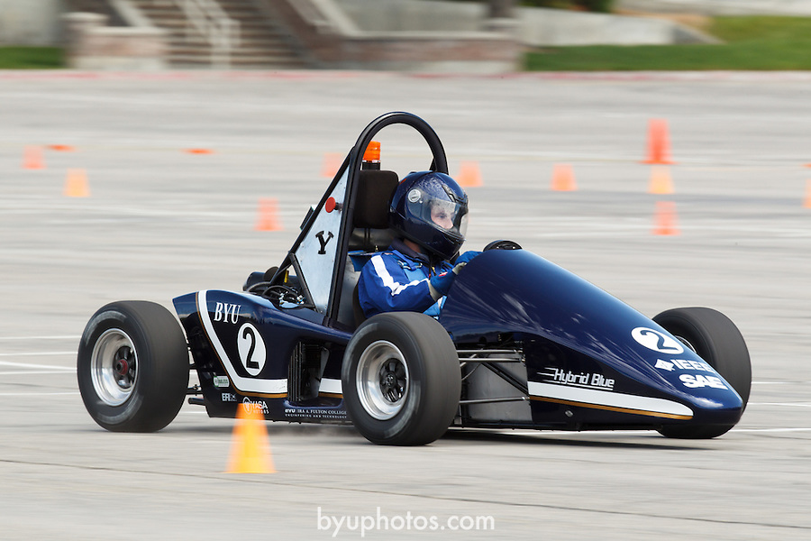 1204-41 213<br /> <br /> 1204-41 Hybrid Racer<br /> <br /> BYU Engineering students and their advisor Dr. Robert Todd test the &quot;Hybrid Blue&quot; racer in the parking lot of Lavell Edwards Stadium.<br /> <br /> April 23, 2012<br /> <br /> Photo by Jaren Wilkey/BYU<br /> <br /> &copy; BYU PHOTO 2012<br /> All Rights Reserved<br /> photo@byu.edu  (801)422-7322