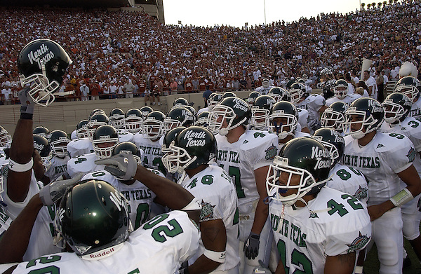 AUSTIN, TX - AUGUST 31: Team, huddle - North Texas Mean Green Football vs University of Texas Longhorns at Darrell K Royal-Texas Memorial Stadium in Austin on August 31, 2002 in No. Photo by Rick