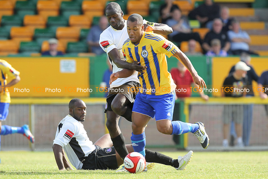 New Romford signing Ryan Imbert tangles with Peter Adgniyi of Dulwich - Romford vs Dulwich Hamlet - FA Trophy 1st Qualifying Round Football at Ship Lane, Thurrock FC - 15/09/12 - MANDATORY CREDIT: Gavin Ellis/TGSPHOTO - Self billing applies where appropriate - 0845 094 6026 - contact@tgsphoto.co.uk - NO UNPAID USE.