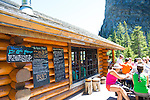 The Lake Agnes Tea House was originally built in 1901 by the Canadian Pacific Railway, as a refuge for hikers and started serving tea in 1905. The log building was replaced in 1981 but still features the original windows, tables and chairs. Situated near Lake Louise, Alberta, Canada, at an altitude of 2,135 meters, (7,005 ft), the Tea House is located on the shores of Lake Agnes. To access the Tea House, take a forested 3.5 km hike from the Chateau Fairmont Lake Louise, with an elevation gain of 400 m or 1,300 ft.  Together with Mirror Lake and Lake Louise, these lakes are often referred to as the 'Lakes in the Clouds'. Lake Agnes was named for original First Lady of Canada - Lady Agnes MacDonald, the wife of Canada's first Prime Minister.