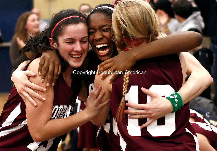 Waterbury, CT-  February 2013-022113CM18-  Left to right, Torrington's  Allison Reardon, Mika Howard and Kelli Balnis embrace as their team goes on to defeat Watertown, 40-38 during the NVL championship in Waterbury Thursday night.   Christopher Massa Republican-American