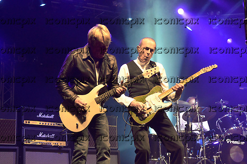 STATUS QUO - Rick Parfitt and Francis Rossi and John Coghlan - performing live on the final date of the Frantic Four Reunion Tour at Wembley Arena in London UK - 17 Mar 2013.  Photo credit George Chin/IconicPix