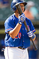 Round Rock Express outfielder Michael Choice (20) at bat during the first game of a Pacific Coast League doubleheader against the Memphis Redbirds on August 3, 2014 at the Dell Diamond in Round Rock, Texas. The Redbirds defeated the Express 4-0. (Andrew Woolley/Four Seam Images)