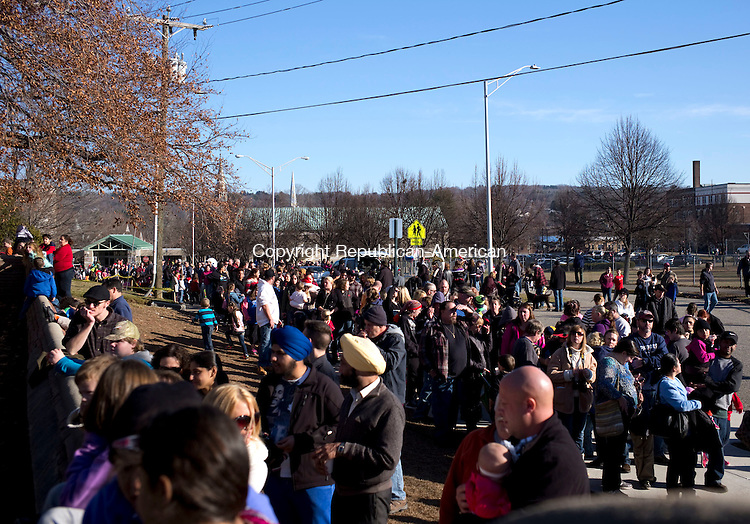 Torrington, CT- 06 December 2015-120615CM10-  Throngs of people wait outside the Christmas Village in Torrington on Sunday.    Christopher Massa Republican-American