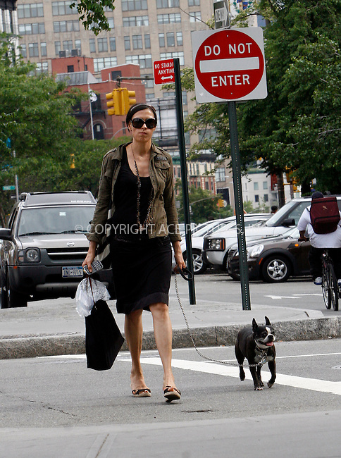 WWW.ACEPIXS.COM . . . . .  ....May 23 2010, New York City....Actress Famke Janssen walking her dog in Soho onn May 23 2010 in New York City....Please byline: NANCY RIVERA- ACEPIXS.COM.... *** ***..Ace Pictures, Inc:  ..Tel: 646 769 0430..e-mail: info@acepixs.com..web: http://www.acepixs.com
