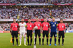 Yoshida Maya of Japan (R2) and Seyed Ashkan Dejagah of Iran (L2) pose for photos among referees prior the AFC Asian Cup UAE 2019 Semi Finals match between I.R. Iran (IRN) and Japan (JPN) at Hazza Bin Zayed Stadium  on 01 January 2014 in Al Alin, United Arab Emirates. Photo by Marcio Rodrigo Machado / Power Sport Images