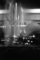 France. Ile-de-france Department. Paris. View on the Eiffel tower at night from a moving subway car. Electric lighting. Artificial illuminations. 23.02.05 © 2005 Didier Ruef