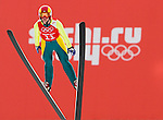 Taylor Henrich of Canada jumps during the Women's Normal Hill Individual training session of the 2014 Sochi Olympic Winter Games at Russki Gorki Ski Juming Center on February 9, 2014 in Sochi, Russia. Photo by Victor Fraile / Power Sport Images