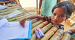 A Rohingya girl leaves a thumbprint to mark that she received supplies from Christian Aid in the Jamtoli Refugee Camp near Cox's Bazar, Bangladesh. <br /> <br /> More than 600,000 Rohingya refugees have fled government-sanctioned violence in Myanmar for safety in this and other camps in Bangladesh..