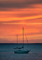 Anchored sailboat at sunrise, Rockland, Maine, USA
