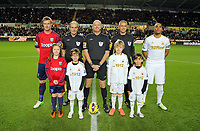 Sunday, 28 November 2012<br /> Pictured: Chris Brunt and Ashley Williams with children mascots and the referees.<br /> Re: Barclays Premier League, Swansea City FC v West Bromwich Albion at the Liberty Stadium, south Wales.