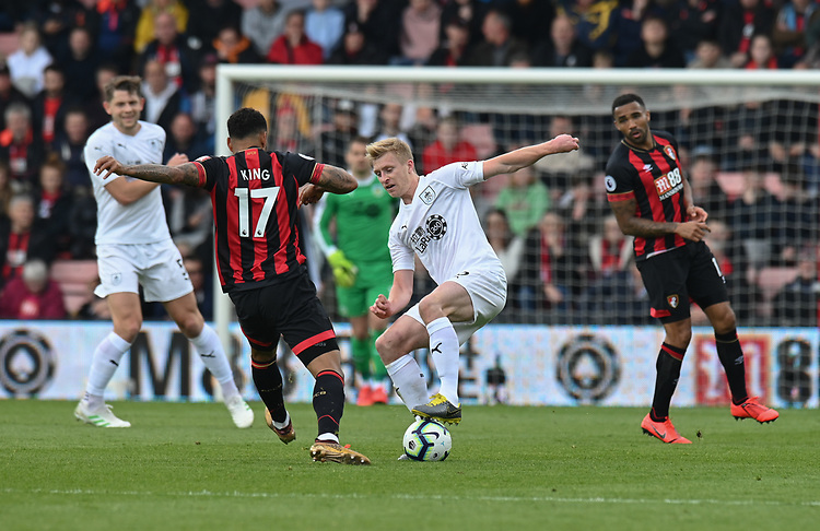 Burnley's Ben Mee (right) battles with Bournemouth's Joshua King (left) <br /> <br /> Photographer David Horton/CameraSport<br /> <br /> The Premier League - Bournemouth v Burnley - Saturday 6th April 2019 - Vitality Stadium - Bournemouth<br /> <br /> World Copyright © 2019 CameraSport. All rights reserved. 43 Linden Ave. Countesthorpe. Leicester. England. LE8 5PG - Tel: +44 (0) 116 277 4147 - admin@camerasport.com - www.camerasport.com