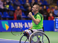 December 21, 2014, Rotterdam, Topsport Centrum, Lotto NK Tennis, Final wheelchair Men's, Maikel Scheffers jubilates his win over  Ronald Vink<br /> Photo: Tennisimages/Henk Koster