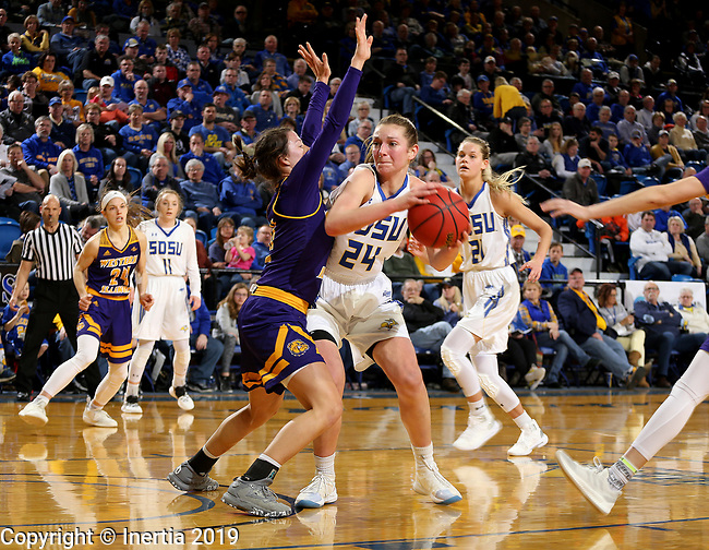 SIOUX FALLS, SD - MARCH 2: Tagyn Larson #24 from South Dakota State University tries to work past the defense of Grace Gilmore #21 Western Illinois Saturday afternoon at Frost Arena in Brookings, SD. (Photo by Dave Eggen/Inertia)