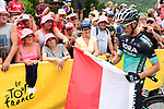Rafal Majka (POL) Bora-Hansgrohe with Polish fans at sign on before the start of Stage 13 of the 2018 Tour de France running 169.5km from Bourg d'Oisans to Valence, France. 20th July 2018. <br /> Picture: ASO/Alex Broadway | Cyclefile<br /> All photos usage must carry mandatory copyright credit (© Cyclefile | ASO/Alex Broadway)
