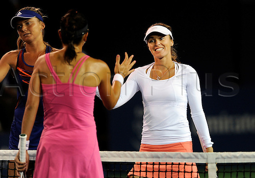 31.07.2013.la Costa Country Club, Carlsbad, California, USA.  Martina Hingis (SUI) makes a comeback to tennis and greets Darija Jurak (CRO) at net after Hingis and her doubles partner Daniela Hantuchova (SVK) defeated Jurak and her partner Julia Goerges (GER) during the Southern California Open played at the La Costa Resort & Spa in Carlsbad CA.