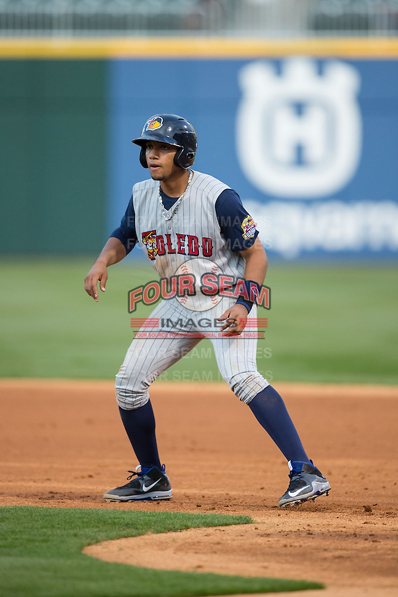 Dixon Machado (28) of the Toledo Mud Hens takes his lead off of first base against the Charlotte Knights at BB&T BallPark on April 27, 2015 in Charlotte, North Carolina.  The Knights defeated the Mud Hens 7-6 in 10 innings.   (Brian Westerholt/Four Seam Images)