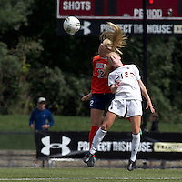 University of Virginia midfielder/defender Shasta Fisher (12) and Boston College midfielder Julia Bouchelle (12) battle for head ball. Boston College defeated University of Virginia, 2-0, at the Newton Soccer Field, on September 18, 2011.