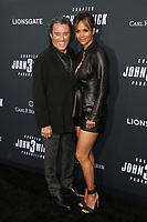 """HOLLYWOOD, CA- MAY 15: Ian McShane and Halle Berry attend the special screening of Lionsgate's """"John Wick: Chapter 3 - Parabellum"""" at TCL Chinese Theatre on May 15, 2019 in Hollywood, California.  <br /> CAP/MPI/SAD<br /> ©SAD/MPI/Capital Pictures"""