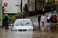Pictured: A car is stranded outside the River View restaurant on the flooded Dulais Fach Road (B4434) between the areas of Aberdulais and Tonna in Neath, south Wales, UK. Saturday 13 October 2018<br /> Re: Flooding caused by Storm Callum in the Neath area, south Wales, UK.
