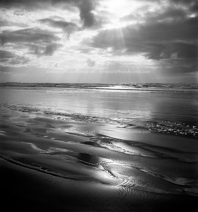 "9969-540228. ""Sand and the Sea"". Cannon Beach. (in This Land This Oregon show) February 28,1954."