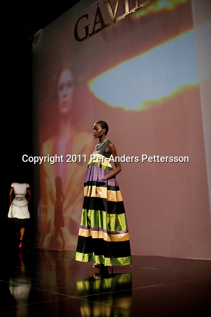 CAPE TOWN, SOUTH AFRICA - JULY 14: A model wears a dress at a show with the Cape Town based designer Gavin Rajah a fashion show at the the Cape Town Fashion Week on July 14, 2011, in Cape Town, South Africa. Some of South Africa's finest designers showed their 2011 Spring and summer collections during the 3 day event. Photo by Per-Anders Pettersson