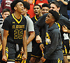 Tyrone Lyons #35 of St. Anthony's, left, and teammates celebrate after their 63-60 win over Chaminade in the NSCHSAA varsity boys basketball final at Hofstra University on Tuesday, Feb. 27, 2018. Lyons recorded 11 points and 11 rebounds in the Friars' victory.