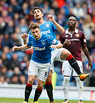 Fabio Cardoso clashes heads with team mate Ryan Jack