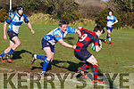 Legally Held<br /> Tralee scrum half Richard Liston holds on to his opposite number Danny Hutchinson Bantry, when the sides met at O'Dowd Park, Tralee last Sunday,