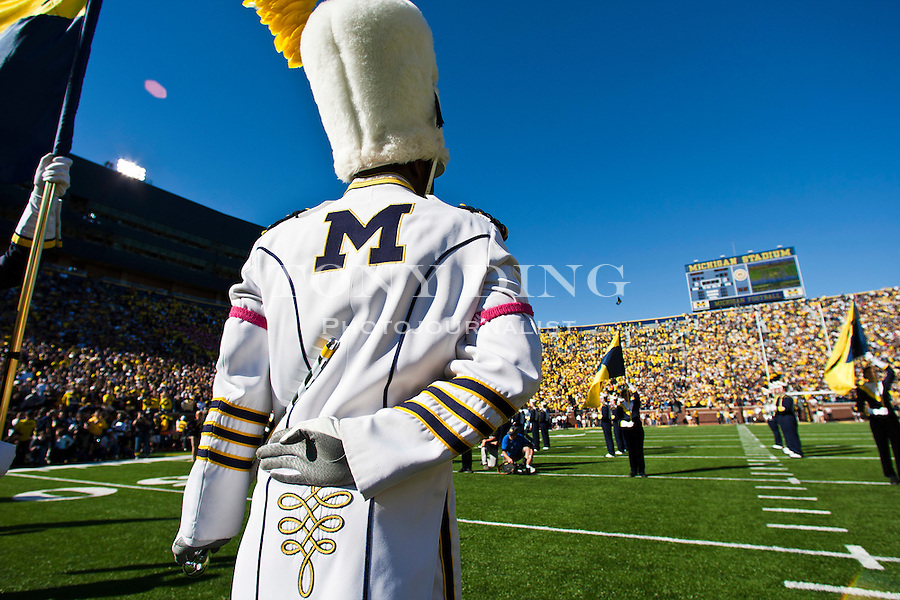 Michigan drum major David Hines Jr. stands ready at attention prior to the Michigan team takes the field before an NCAA college football game with Iowa, Saturday, Oct. 16, 2010, in Ann Arbor, Mich. (AP Photo/Tony Ding)