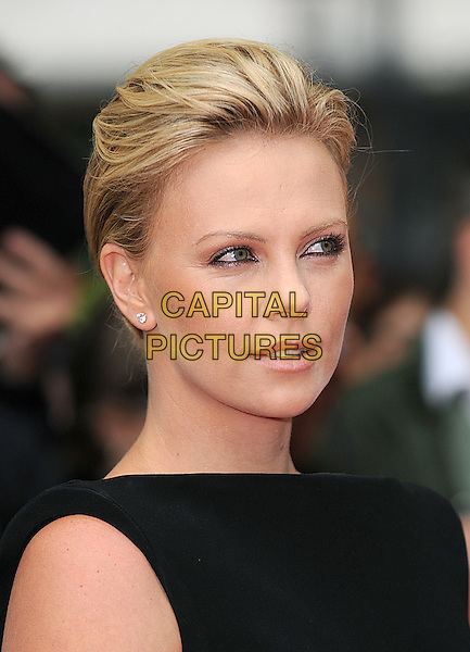 "CHARLIZE THERON.attending the UK Premiere of ""Hancock"" in Leicester Square, London, England,.18th June 2008.portrait headshot wrinkles eyes diamond stud earrings black .CAP/BEL.©Tom Belcher/Capital Pictures"