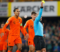 16th November 2019; Windsor Park, Belfast, Antrim County, Northern Ireland; European Championships 2020 Qualifier, Northern Ireland versus Netherlands; Referee Szymon Marciniak showing a yellow card to Jasper Cillessen of Netherlands - Editorial Use