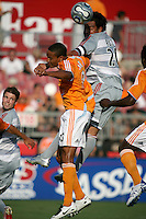 FC Dallas forward Carlos Ruiz (20) heads the ball over Houston Dynamo midfielder Ricardo Clark (13). Houston Dynamo defeated FC Dallas 1-0 during an MLS regular season match at Robertson Stadium in Houston, TX on August 19, 2007.