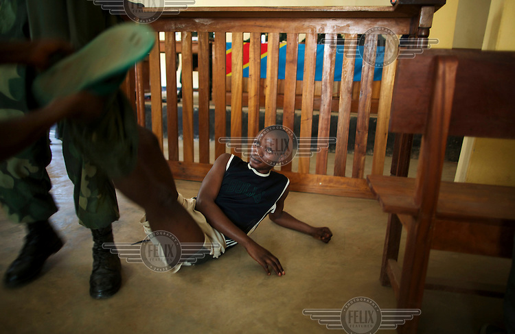 Commandant Kado Miranga has his military uniform ripped off of him after being sentenced to 20 years for rape. His trial took place in a mobile military court.